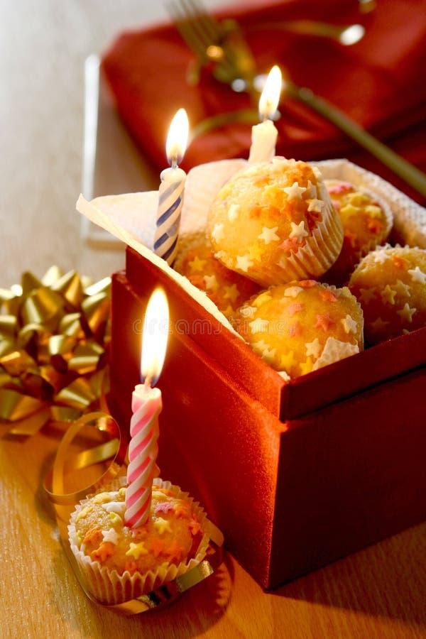 A box full of mini star fairycakes stock images