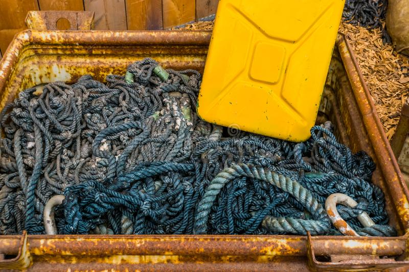 Box full of ropes and a jerry can, sailing equipment, nautical background. A box full of ropes and a jerry can, sailing equipment, nautical background royalty free stock photography
