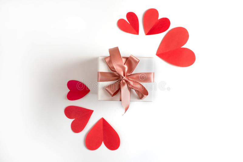 Box with a gift on the background of red hearts White isolated background royalty free stock images