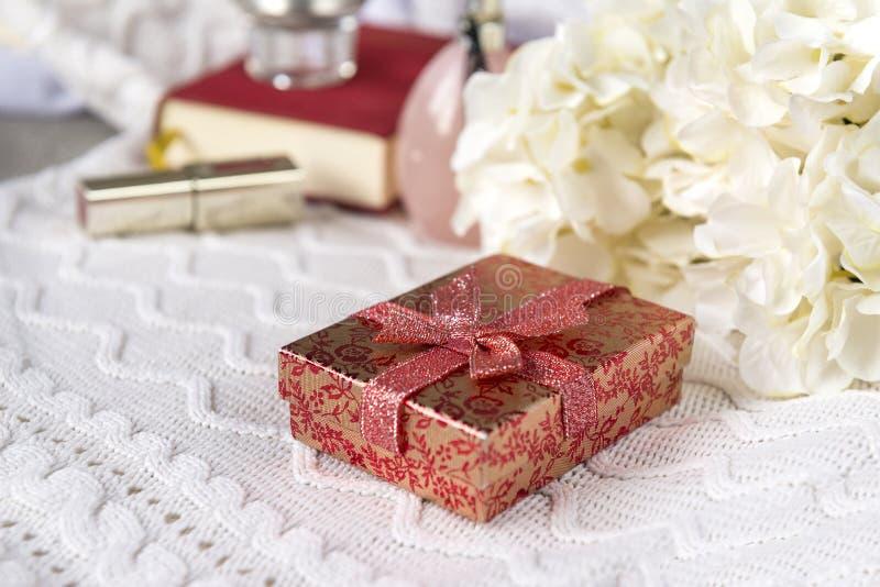 Box, gift, white, cloth, candle, hydrangea flowers, lipstick, still life. Perfume bottle, perfume stock photos
