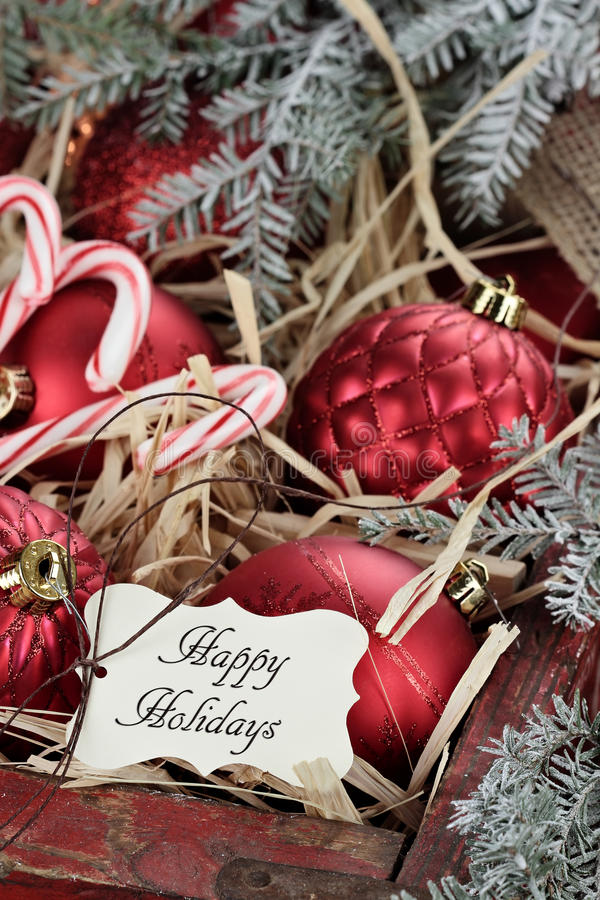 Box of Glass Christmas Ornaments and Holiday Tag stock photos