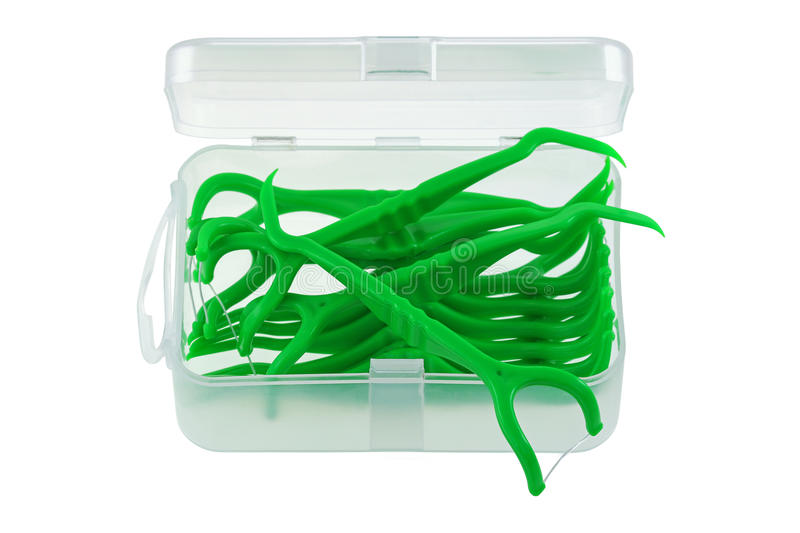 A box of green dental flossers (Floss Pick) stock images