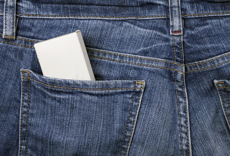 Box in the jeans pocket royalty free stock images