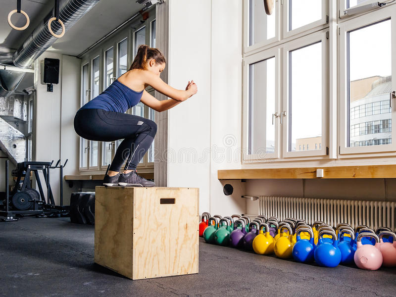 Box jump at the gym royalty free stock image