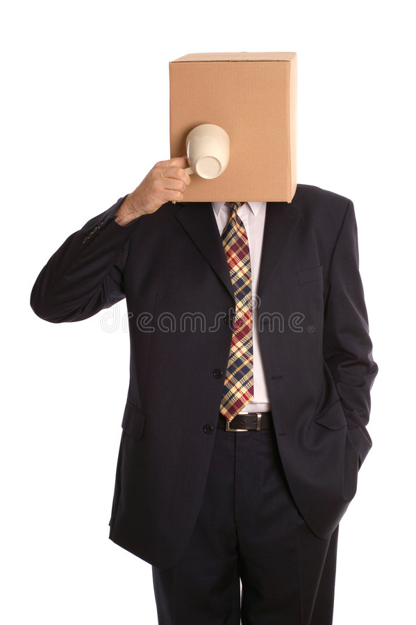 Box man coffee break. An anonymous businessman trying to drink some coffee royalty free stock photo