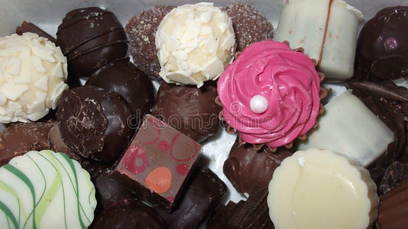 Box of mixed chocolates stock images