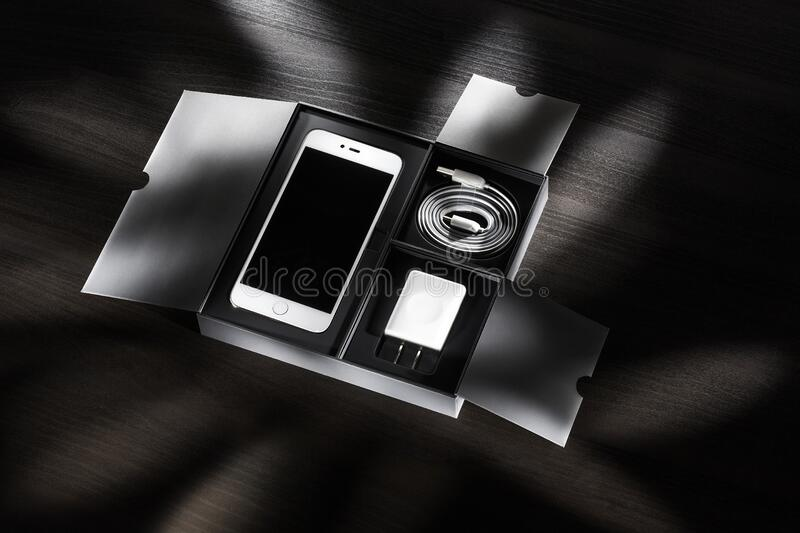 Box with new smartphone royalty free stock photography