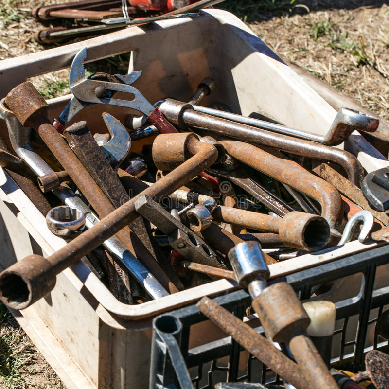 Box of second hand rusted hardware tools at boot sale royalty free stock photography