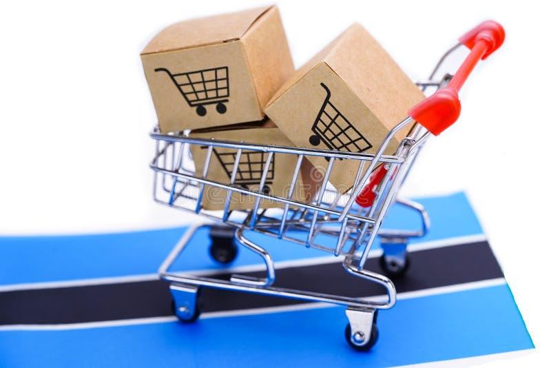 Box with shopping cart logo and Botswana flag. royalty free stock photography