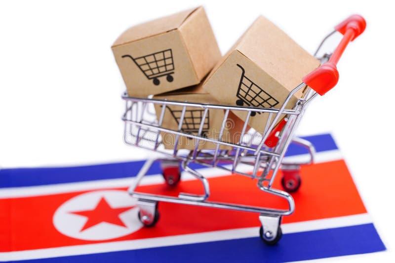 Box with shopping cart logo and North Korea flag royalty free stock photos