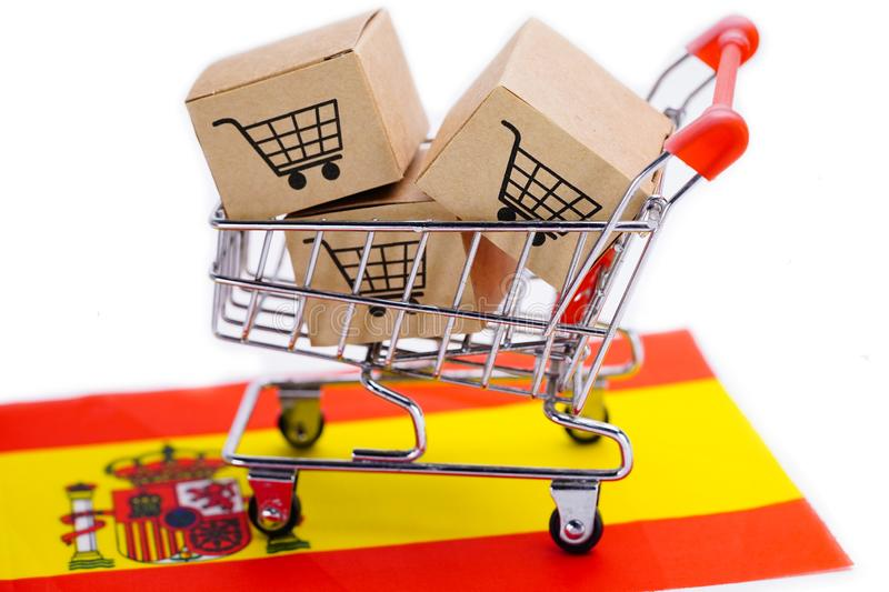 Box with shopping cart logo and Spain flag. royalty free stock photos