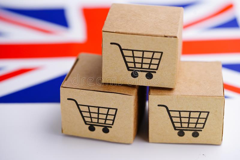 Box with shopping cart logo and United Kingdom flag : Import Export Shopping online or eCommerce finance delivery service store pr stock image