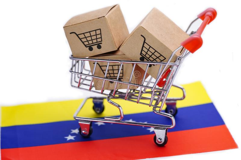 Box with shopping cart logo and Venezuela flag :. Import Export Shopping online or eCommerce finance delivery service store product shipping, trade, supplier royalty free stock photo