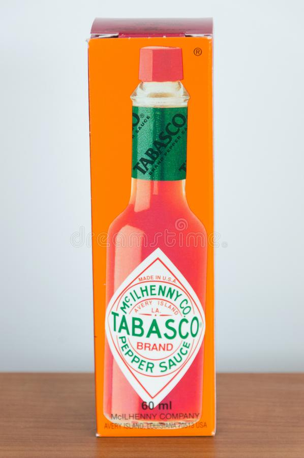 Box of Tabasco sauce on wooden table. Tabasco sauce is hot sauce made from tabasco peppers, vinegar and salt. royalty free stock photography