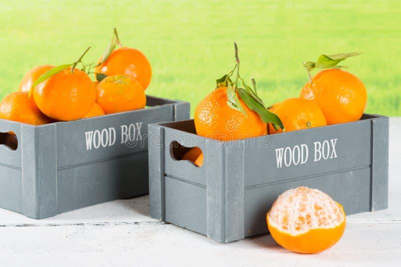 Box of tangerines stock photos