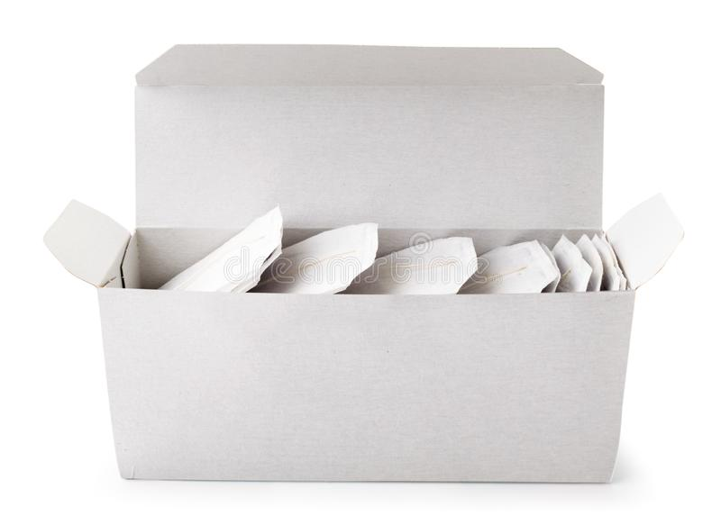 Box with tea bags close-up on a white. Isolated royalty free stock photography