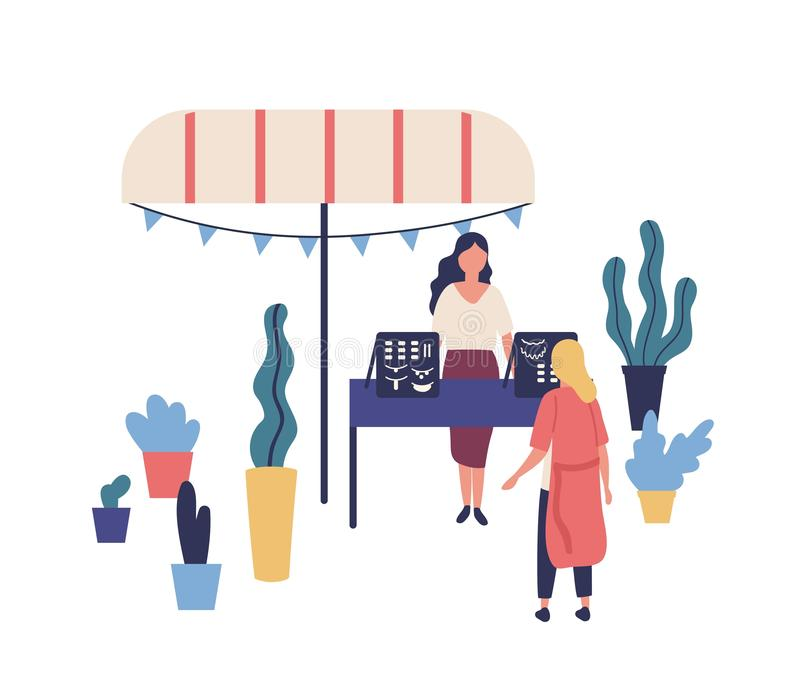 Box of teller met met de hand gemaakte juwelen of bijouterie, vrouwelijke verkoper en klant bij creatief de zomer openluchtfestiv royalty-vrije illustratie