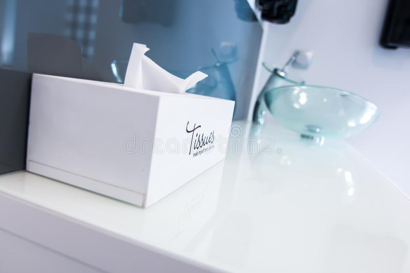 Box of tissues on sink royalty free stock photos