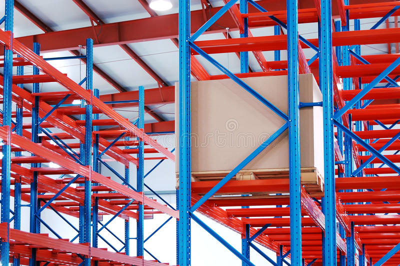 Box on warehouse shelf royalty free stock images