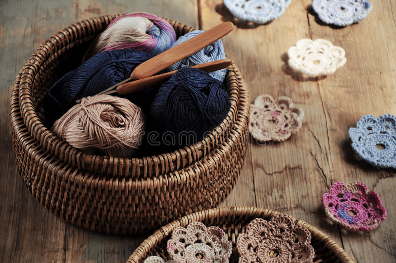 Box of yarn and crocheted flowers royalty free stock photo