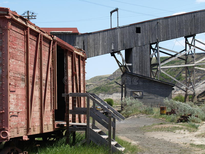 Boxcar and mine shaft. This boxcar is part of a coal mine museum display at eastcoulee alberta canada stock images