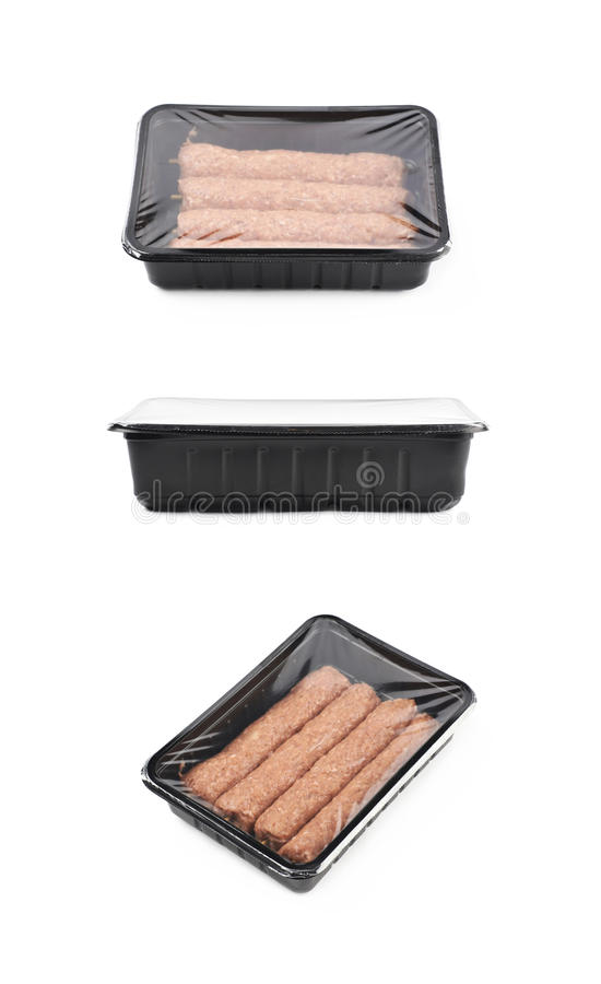 Boxed raw kebab meat isolated. Boxed raw kebab meat on a wooden stick, composition isolated over the white background, set of three different foreshortenings stock photo
