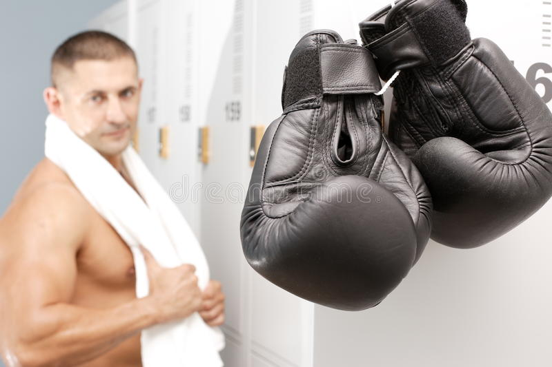 Boxer. Young boxer with gloves and smile on face stock photo