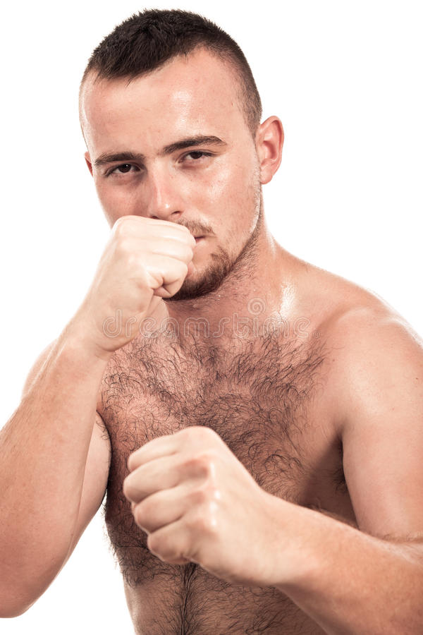 Boxer. Portrait of young shirtless male boxer, isolated on white background royalty free stock image