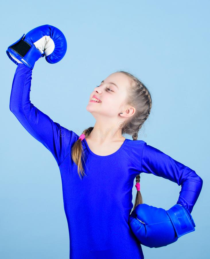 Boxer child in boxing gloves. Rise of women boxers. Female boxer change attitudes within sport. Free and confident. Girl. Boxer child in boxing gloves. Rise of stock image