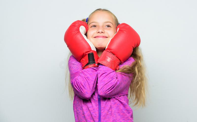 Boxer child workout, healthy fitness. knockout and energy. Sport success. training with coach. Fight. Sport and royalty free stock photo