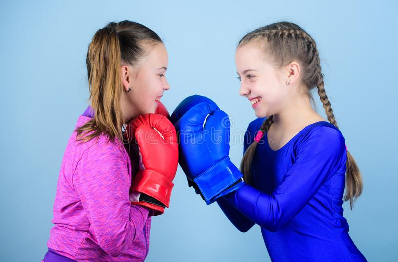 Boxer children in boxing gloves. Girls cute boxers on blue background. Friendship as battle and competition. Pass boxing royalty free stock image