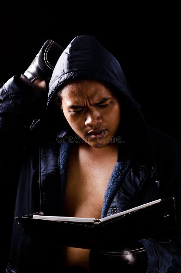 Boxer confusing his book stock photos
