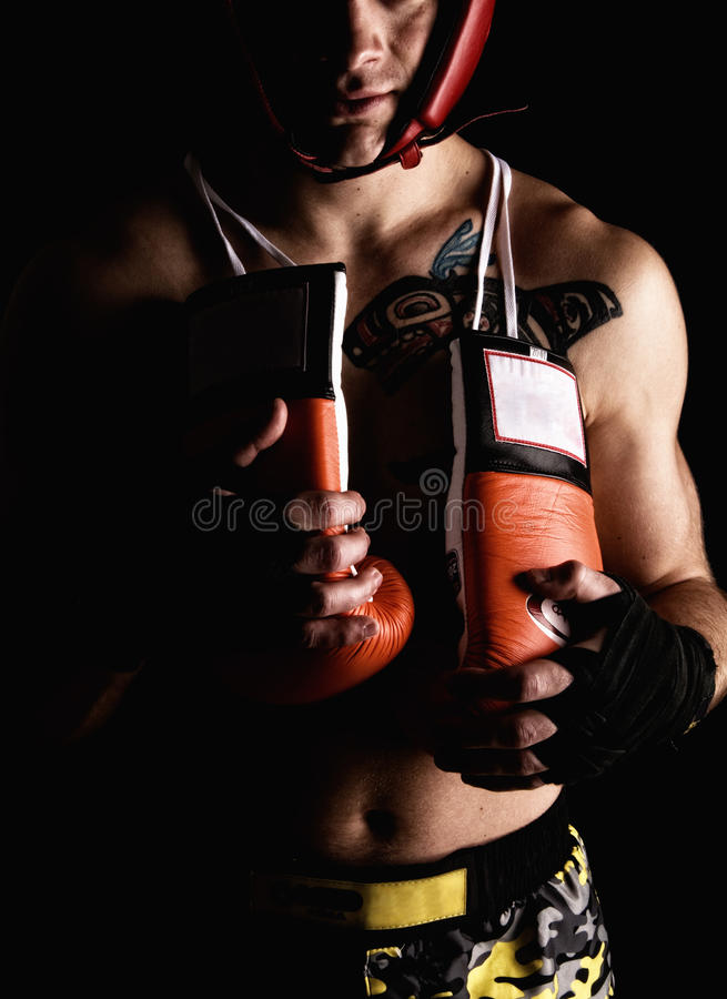 Boxer fighter. Over black background royalty free stock image