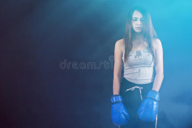 Boxer girl boxing gloves worth tired and sweaty copyspace royalty free stock photos
