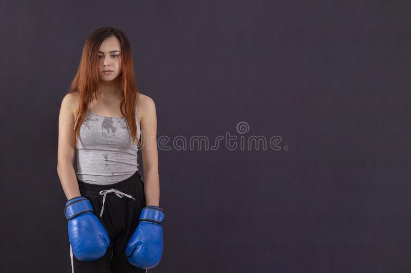 Boxer girl boxing gloves worth tired and sweaty copyspace royalty free stock photo