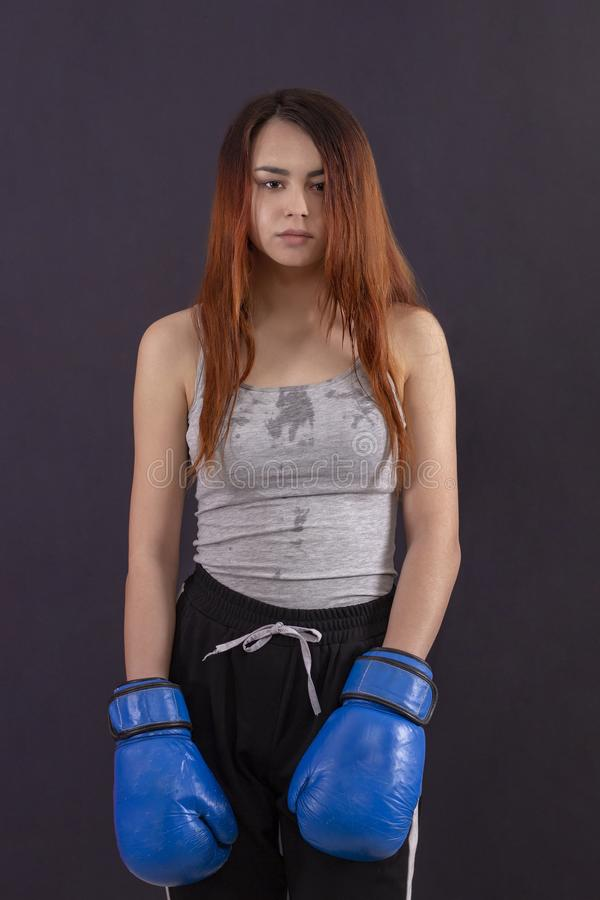 Boxer girl boxing gloves worth tired and sweaty royalty free stock images