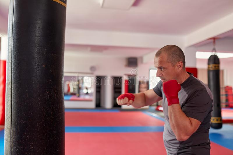 Boxer with heavy bag stock photos