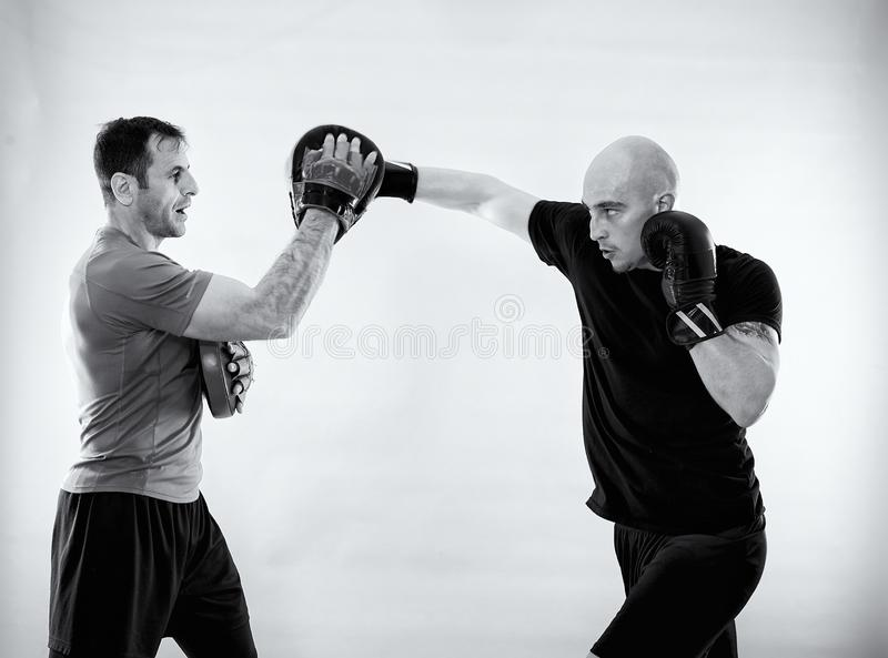 Black and white of boxer with trainer royalty free stock image
