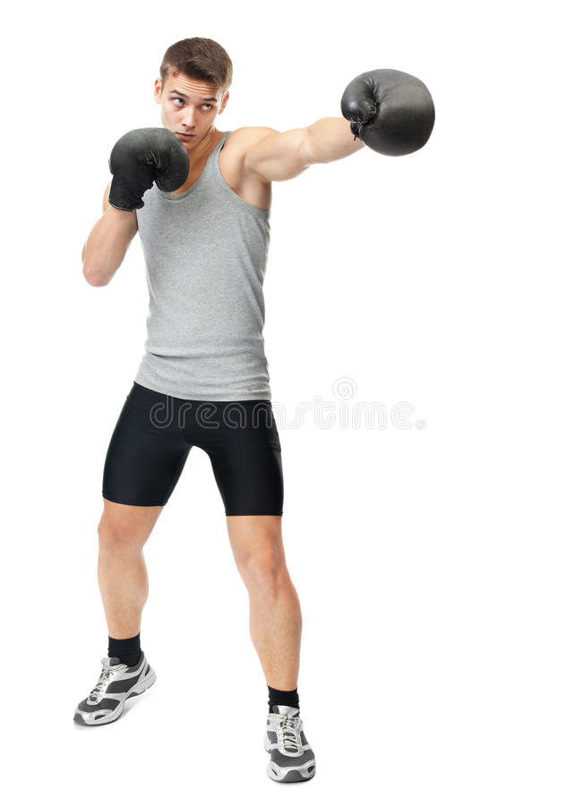 Boxer making punch. Full length portrait of young boxer making punch isolated on white background royalty free stock images