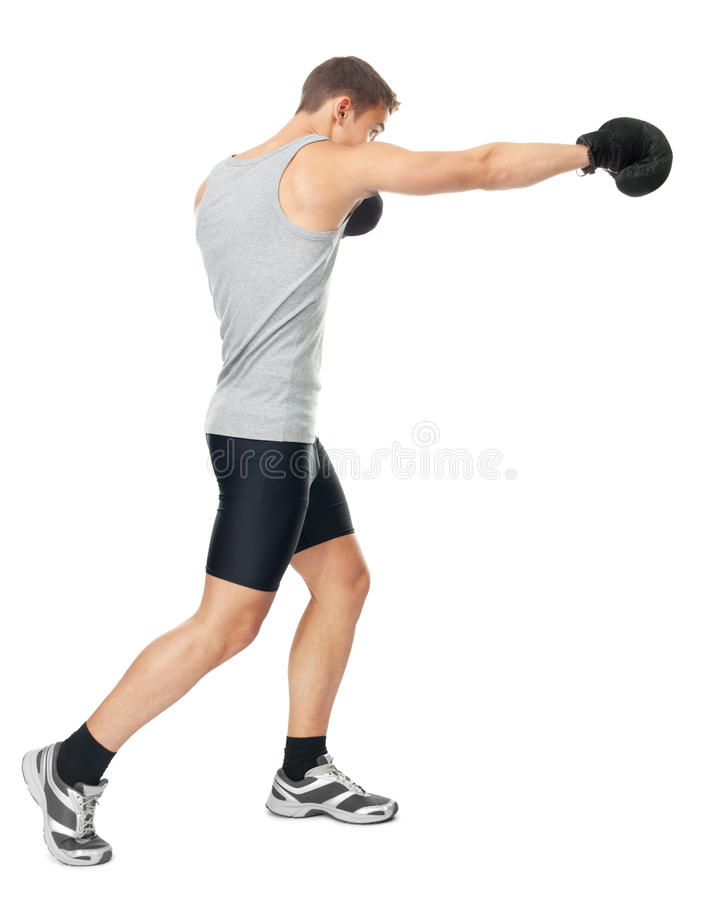 Boxer making punch. Full length side view portrait of young boxer making punch isolated on white background stock photo