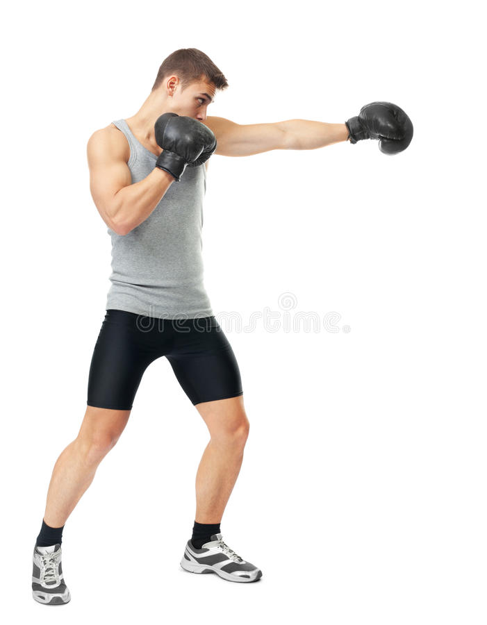 Boxer making punch. Full length side view portrait of young boxer making punch isolated on white background stock image