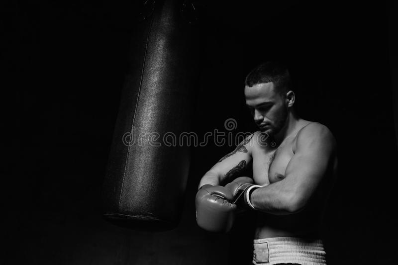 Boxer man putting on boxing gloves stock photo