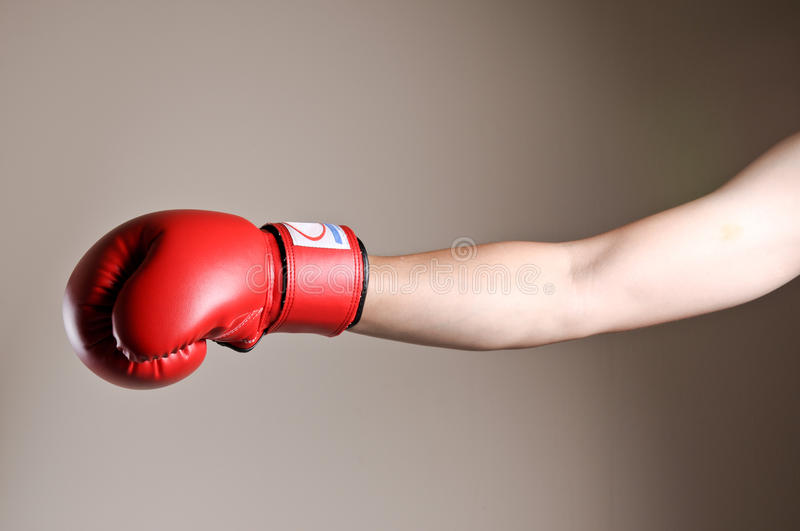 Boxer punching in studio stock images
