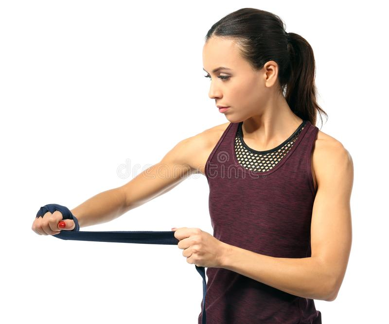 Boxer woman applying wrist wraps stock image