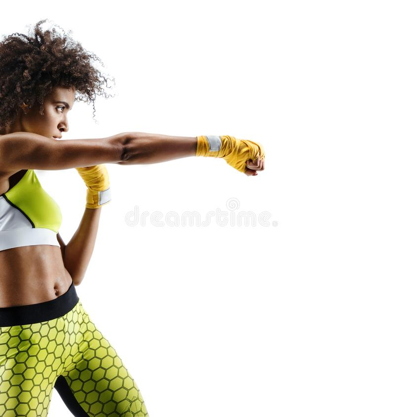Boxer woman in yellow bandages making direct hit royalty free stock images