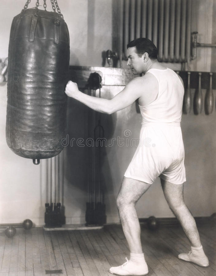 Boxer working out at gym stock image