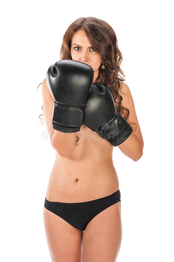 Boxer young girl poses in the studio with boxing gloves stock photo