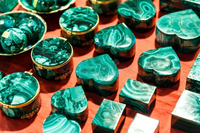 Boxes and accessories from malachite. Beautiful green boxes and accessories from malachite royalty free stock photos