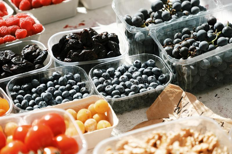 Boxes with berries and nuts from farmers market royalty free stock images