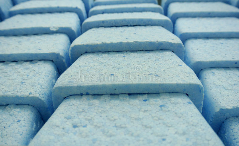 Boxes in blue styrofoam stock image